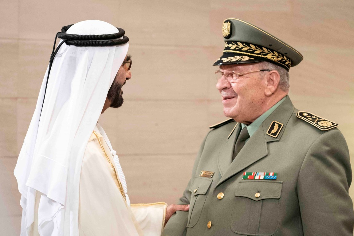 ABU DHABI, UNITED ARAB EMIRATES - December 2, 2018: HH Sheikh Mohamed bin Rashid Al Maktoum, Vice-President, Prime Minister of the UAE, Ruler of Dubai and Minister of Defence (L), greets HE Ahmed Gaid Salah, Vice Minister of Defense, and Chief of Staff of the Algerian People's National Army (R), prior to the official 47th UAE National Day Celebration 'This is Zayed. This is the UAE' at Zayed Stadium.  ( Ryan Carter / Ministry of Presidential Affairs ) ---