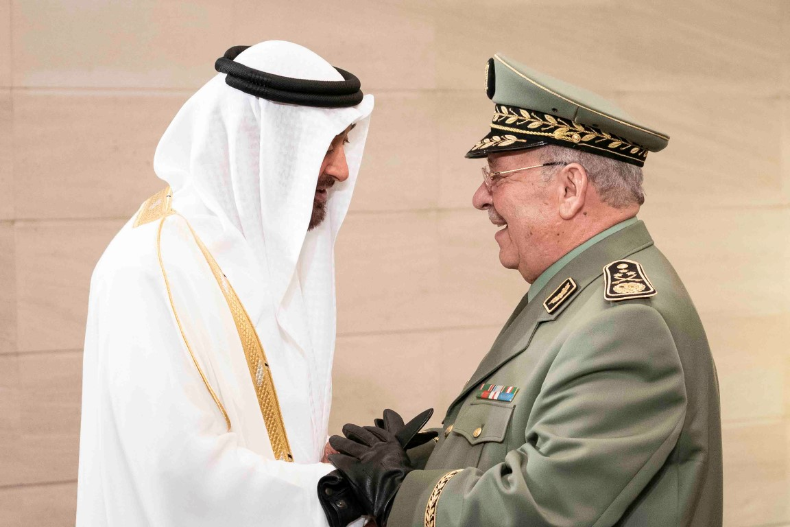 ABU DHABI, UNITED ARAB EMIRATES - December 2, 2018: HH Sheikh Mohamed bin Zayed Al Nahyan, Crown Prince of Abu Dhabi and Deputy Supreme Commander of the UAE Armed Forces (L), greets HE Ahmed Gaid Salah, Vice Minister of Defense, and Chief of Staff of the Algerian People's National Army (R), prior to the official 47th UAE National Day Celebration 'This is Zayed. This is the UAE' at Zayed Stadium.  ( Ryan Carter / Ministry of Presidential Affairs ) ---